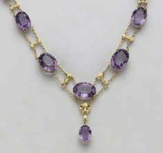 AN ANTIQUE AMETHYST AND GOLD NECKLACE   8 oval-cut amethysts ranging from 2.80 to 9.00 carats each  Circa 1900