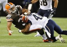 Cleveland Browns running back Miguel Maysonet is tackled by St. Louis Rams defensive back Drew Thomas during the third quarter preseason 2013