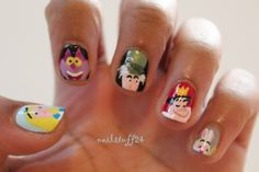 I love these, Alice in Wonderland rocks!! This nail-artist is seriously talented ;)