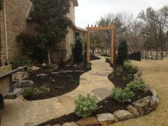 Flagstone pathway that leads around the house with plantings along the side. Flagstone pathway that leads around the house with plantings along the side. Flagstone pathway that leads around the house with plantings along Flagstone Pathway, Stone Walkway, Garden Types, Garden Paths, Landscaping Company, Backyard Landscaping, Landscape Services, Outdoor Living Areas, Pathways
