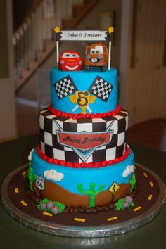Cars - Lighting Mcqueen and Mater sculpted out of fondant...used edible images for flags, banner, cars logo and signs.  TFL!