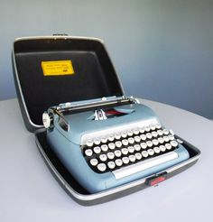 Smith Corona portable typewriter...lap top of the 80's...I remember typing all those papers...and that horrible eraser thing...then came WHITE OUT!!!