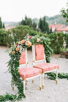 Bride and Groom Chairs with a Floral Garland | Maria Lamb Photography | Gracious Villa Wedding in the Heart of Tuscany