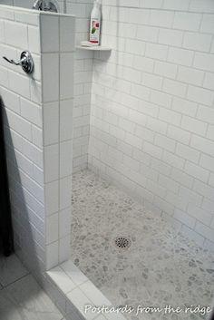 Bathroom, : Interesting White Bathroom Design Ideas Using White Pebble Tile Shower Floor And White Subway Tile Shower Wall Pebble Tile Shower Floor, White Subway Tile Shower, Subway Tile Showers, Bathroom Floor Tiles, White Bathroom, Rock Shower, White Shower, Subway Tiles, Bathroom Showers