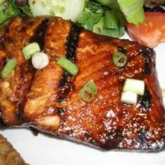 Honey-Ginger Grilled Salmon  Marinated for 2 hours. Baked at 425 for 15 min then broiled for 2 min. Really good!