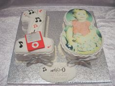 Numerical shaped number 18 cake with and iPod and music symbols and photograph placed on the 8  http://www.cakescrazy.co.uk/details/number-18-cake-photo.html