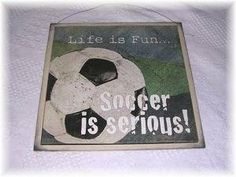 """Life Is Fun Soccer Is Serious Wooden Boys Sports Bedroom Decor Sign Wood Signs by The Little Store of Home Decor. $14.99. Made in the USA. size 13x13. We've sealed this Soccer is Serious print onto wood giving it a framed appearance. The background is a creamy ivory color with touches of brown and black to accent the print. It measures approximately 13"""" squared by 1/4"""" thick (wood dimensions not including hanger). We've added a rusty tin wire for easy hanging"""
