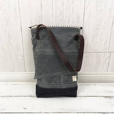 Waxed Canvas bag / tote with leather straps, available in three colors. The Tracy Tote is an oilskin (waxed canvas), denim, and leather everyday tote or market bag. Available in either Confederate Grey (shown), British Antique, or Field Tan, this will be your everyday, go-anywhere