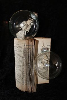 "1892 Hymnal Angel Ornaments by Jodi Brown via WetCanvasArt on Etsy. A set of two miniature angels tucked inside glass ornaments. Each angel is hand made from the pages of a hymnal dating from 1892.  SEE more of Jodi's work on my board ""Art ~ Jodi Harvey-Brown."""