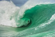 Nathan Fletcher charging thick Teahupoo in Tahiti. That's a lot of water overhead.