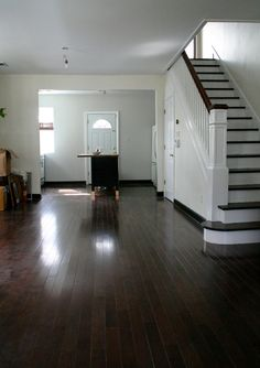 dark wood baseboards and floors. Do I paint the trim white, or let it be dark? Dark Baseboards, Wood Baseboard, Baseboard Styles, Craftsman Trim, Craftsman Interior, Interior Trim, Interior Stairs, Hall Wall Decor, Cozy Home Decorating