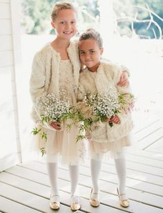 What can be cuter than a couple of little princesses with flower petals? Keep the babies warm yet stylish with fur or knit boleros, cardigans...