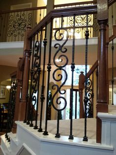 For the Harris' Houston home, we replaced their wooden balusters with new powder coated wrought iron pieces.  The new balusters, our PC18/1, PC18/2, PC 33/2, and PC26/1, all with our Midnight Black finish, dramatically transformed the profile of the staircase.  Just take a look!