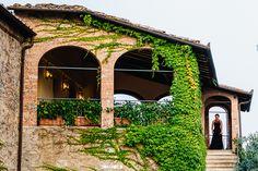 Borgo San Felice Wedding Photographer - bride leaving the bridal suite for her wedding #destinationWedding #TuscanyWedding // www.jonmoldweddings.com