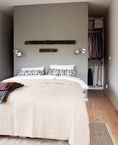 love the idea of a behind of bed wall hidden closet. we have to do this.