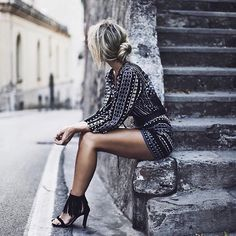 Love. LIke her outfit and the way it contrasts with the stairs.