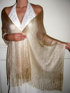 GOLD NET SHAWL AND A SILVER NET SHAWL IS A NECESSITY FOR EVERY WOMAN SO GIFT ONE TODAY AND STOCK UP FOR YOURSELF TOO. NETTED LIGHT SHAWLS WITH EVENING SHIMMER ARE SUCH A BEAUTIFUL TOUCH FOR EVENING WEAR. http://www.yourselegantly.com/dressy-evening-shawls/netted-lace-shawls.html