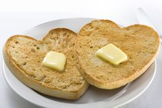 """The warmth of your love makes my heart melt like this butter is melting on this warm bread toast.."" Express your love with these heart shaped toasts with butter to let your sweetheart know what's in your heart <3"