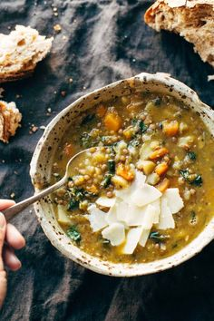 Detox Crockpot Lentil Soup - a nourishing and easy soup recipe made with onions, garlic, carrots, kale, olive oil, squash, and lentils. Vegan / vegetarian / gluten free and SUPER delicious! | pinchofyum.com: