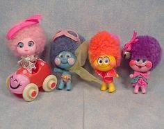 Upsy Downsy dolls.  The second one from left looks like a flying Green Giant.