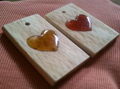 Self-made wooden pendants with resin heart. It is made of oak wood and resin of spruces from forest. The one on right is with red glitter, and on the left it is just 100% pure resin from spruces. = )