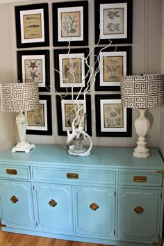 Goodwill furniture makeover, robin's egg blue console, ballard designs lamps, coastal artwork