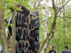 EEC climbing the tyre wall at the No Ego Challenge