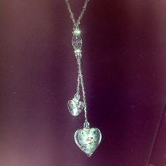 beautiful glass heart necklace It's so pretty it has beading all over chain then drops in to a small heart shape then a longer bigger heart at bottom in the heart it has different colors which make it very pretty bought at a boutique wore once only in EUC Jewelry Necklaces