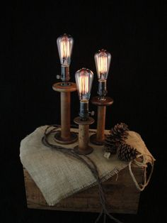 SET OF THREE vintage wood bobbin lamps. We picked up these three wooden textile bobbins in an old mill town here in Georgia. These are actual Industrial Lighting, Vintage Lighting, Cool Lighting, Vintage Lamps, Lighting Ideas, Wood Spool, Wooden Lamp, Lamp Sets, Lampshades