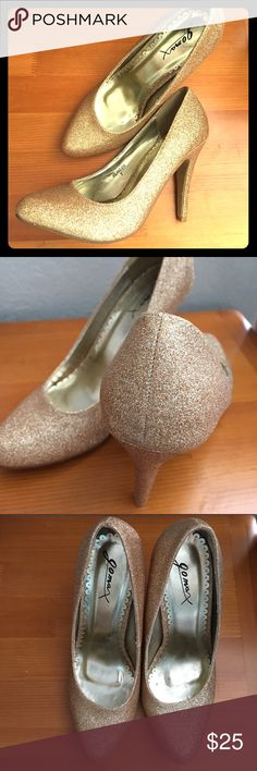 Gorgeous glitter gold heels Beautiful gold glitter heels with round toe and 4 inch heel. Only worn once. Great condition and fantastic statement shoes. Shoes Heels