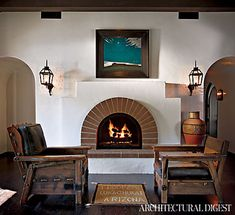 Steal Diane Keaton's Spanish style look by mixing outdoor lantern style sconces around an indoor fireplace.