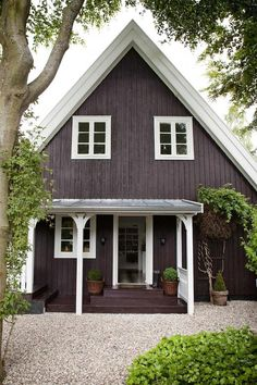 A wrong turn led a Danish couple to their dream A-frame house where deer stray into the garden. The couple undertook a thorough renovation, replacing roof tiles, updating the bathroom and installing an English country style kitchen. Cottage Exterior, Exterior House Colors, Exterior Design, Exterior Paint, A Frame House Plans, A Frame Cabin, Dark House, House Siding, Cottage Homes