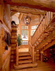 Gorgeous exposed wood staircase for log cabins and homes wanting that country/mountain flair.
