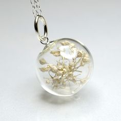 So Pretty - White dried baby's breath flower blown glass ball sterling silver necklace. $32.00, via Etsy.