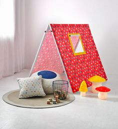 How to make a kids' fabric tent: Kids love having a special place to play, and this cute and cosy campsite is an ideal addition to a bedroom or living area.