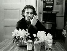Johnny Depp at Allen Ginsberg's kitchen table, New York City, 1994. c. Allen Ginsberg Estate