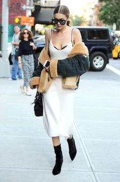 So much love for this Gigi Hadid ensemble: a Victoria Beckham Collection slip dress, Chloé flight jacket, Versace bag and Karen Walker sunglasses. @intentjewellery via ASOS