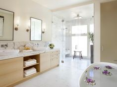 Neat! Look how big!... Marble pattern, rain shower and glass door... Marble half wall running into shower...