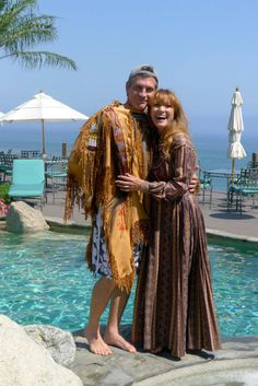 Picture of Juli 10, 2013. Jane and Joe frolick by the pool trying on old Costumes from Dr Quinn, Medicine Woman.
