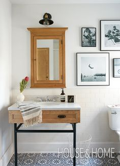 In this kids' bathroom, patterned cement floor tiles and a custom vanity are charming, rustic touches. | Photographer: Maxime Desbiens | Designer: Mélanie Cherrier