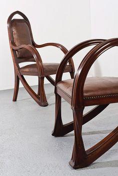 ** Louis Majorelle (France 1859–1926), Nancy, Arm Chairs, Mahogany.