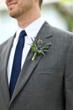Blue tie with a grey Jos. A. Bank suit; Wow, that is really classy. Add a coral boutonniere and it's in the running.