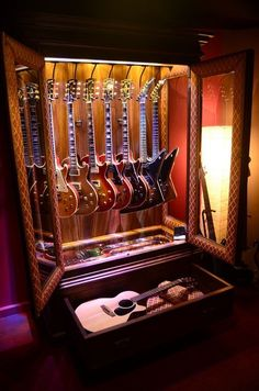 21 Various DIY Display Case Ideas to Keep your Beloved Stuff! DIY Display Case Ideas – The majority of us currently have the ingredients of a collection remaining on a shelf or cabinet, right under our noses. Guitar Display Case, Guitar Storage, Display Cases, Home Studio Musik, Music Studio Room, Guitar Wall, Cool Guitar, Guitar Hooks, Ideas Armario