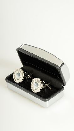 Rotary dial shaped steel cuff-links featuring toggle clasps.
