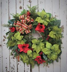 Size Red Amaryllis, Lime-glitter Poinsettia, Sage Eucalyptus with a Red and Green Stripe Bow Holiday Wreaths, Christmas Decorations, Winter Wreaths, Red Christmas, Christmas Time, Wreaths For Front Door, Door Wreath, Green Stripes, Poinsettia