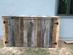 Hiding Trash Cans Using Old Barn Wood