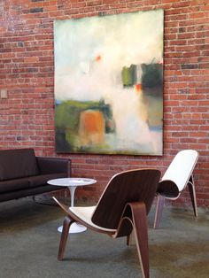 Coupled, furniture+art at modernclassics.com Bellingham Showroom. Gravity by Sharon Kingston paired with Wegner Shell Chairs and Loveseat