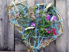 "We've done the ""Y"" shaped stick  - a weaving of yarn and flowers... this time I was thinking of a frame.  A frame for the end of summer..."
