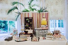 Love the look of this sweets table!! And check out the yellow ombre cake, @Lisa Phillips-Barton Choinard!!!