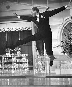 American dancer and film star Fred Astaire (1899 - 1987) executes some intricate steps among the glasses on a bar in the RKO Radio musical comedy 'The Sky's the Limit', 1943.